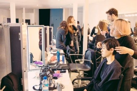 Hair stylist preparing a model before the show | Alexander Lewis AW16 Presentation - Behind the Scenes at London Fashion Week