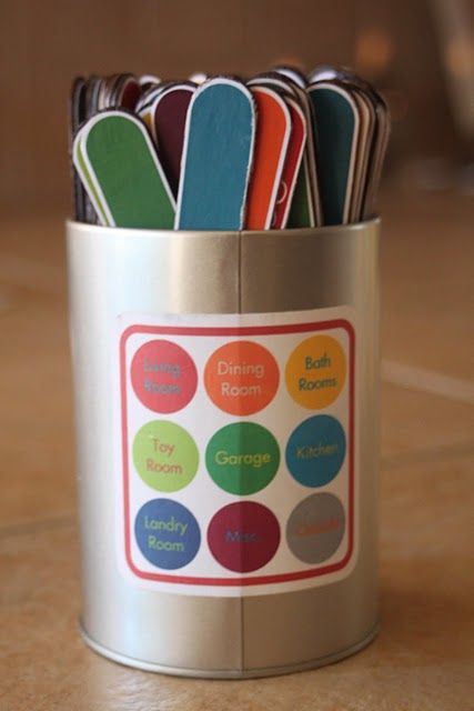 Craft sticks, craft-stick-shaped printables, modge-podge.  Each stick is color-coded to match an area of the house.  One very detailed chore per stick.
