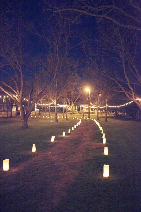 lanterns lining the walkway + hanging lights in the trees // wedding reception