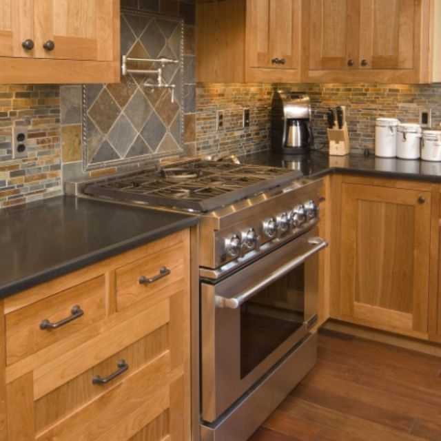 Love this look with the hickory cabinets and dark counters for Backsplash colors for dark cabinets
