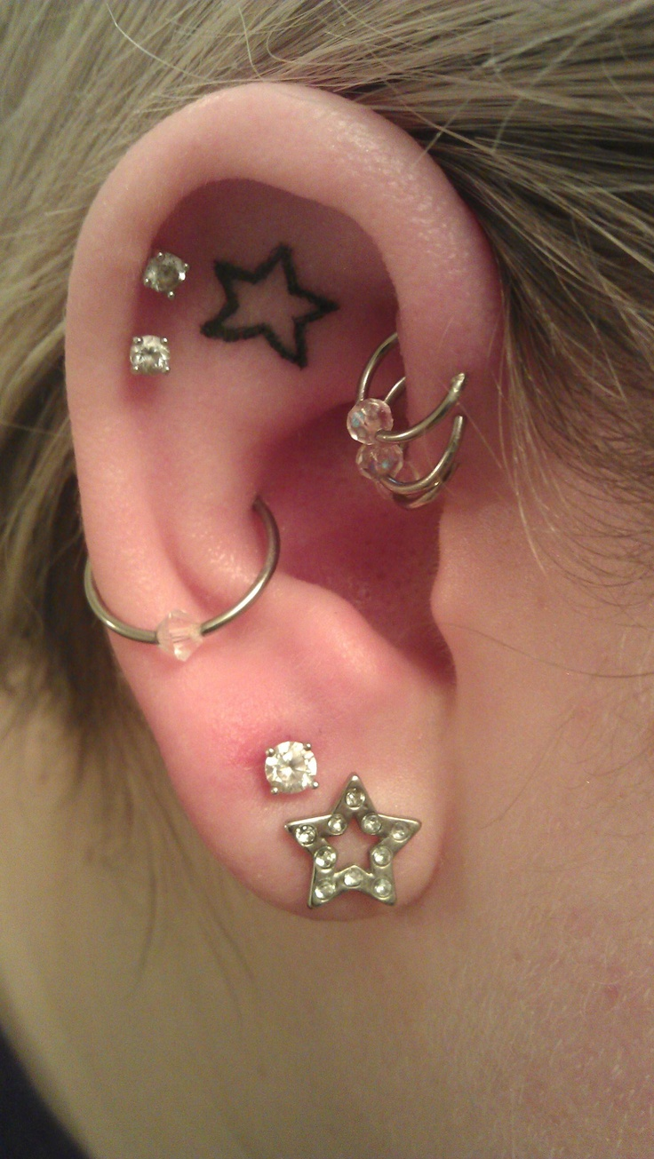 Star Ear Tattoo - If I didn't disagree with the idea of having a tattoo that's the 1st one I'd get. I love the way a tattoo on ear cartilage looks && stars are my favorite thing ever! BTW this picture is almost an exact layout of the way I'd do my right ear (if I just went nuts) :))