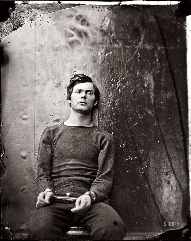 Shorpy Historical Photo Archive :: Lewis Payne, seated and manacled, at the Washington Navy Yard about the time of his 21st birthday in April 1865, three months before he was hanged as one of the Lincoln assassination conspirators. Photograph by Alexander Gardner, probably taken aboard the ironclad U.S.S. Montauk or Saugus.