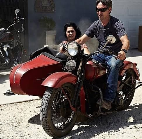 Mike Wolfe and Danielle Colby from American Pickers on a 1937 Harley Flathead