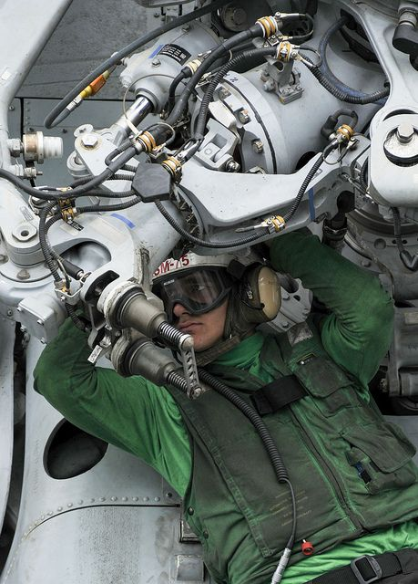 """U.S. 5TH FLEET AREA OF RESPONSIBILITY (Aug. 17, 2013) – Aviation Structural Mechanic 3rd Class Michael B. Herring performs maintenance on the rotor of an MH-60R Seahawk helicopter assigned to the """"Wolf Pack"""" of Helicopter Maritime Strike Squadron (HSM) 75 on the flight deck of the aircraft carrier USS Nimitz (CVN 68). (U.S. Navy photo by Mass Communication Specialist Seaman Eric M. Butler/Released)"""