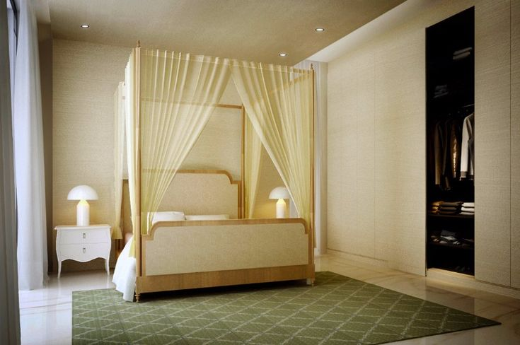 A charming bedroom design that takes a pair of sleek nightstands and chandeliers and blends them with a beautiful classical canopy bed.