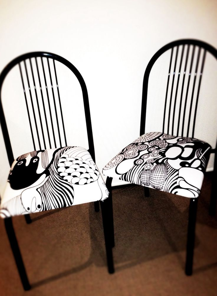 Nailed it! Re-upholstered dinning chairs using IKEA fabric.