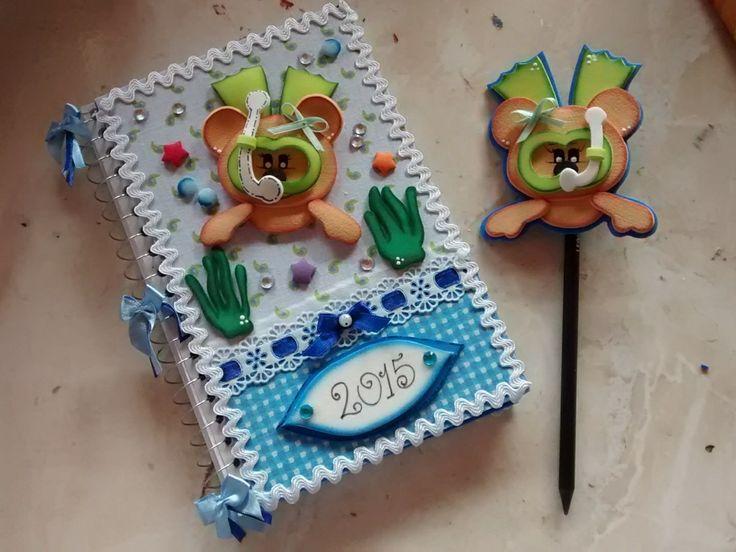 Caderno pequeno encapado com eva e revestido em tecido,tema a sua escolha,e ponteira também toda em eva já incluído o lápis
