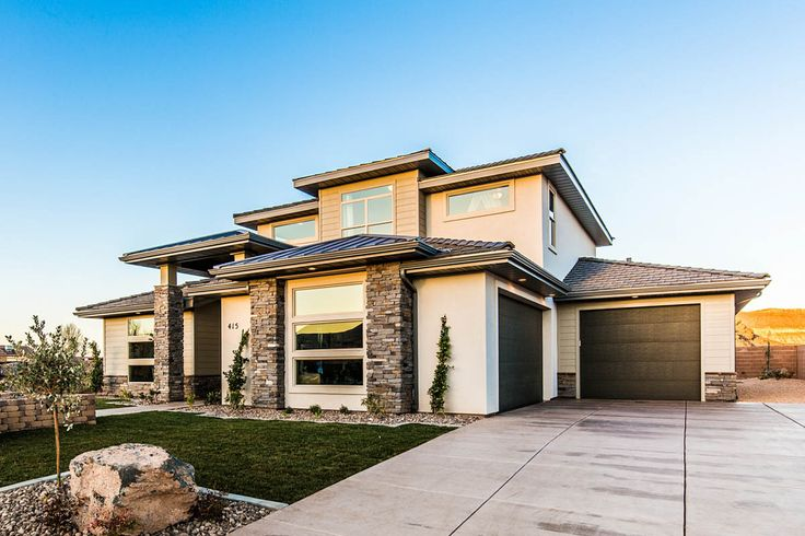 The Scott's Bluff house plan. A prairie style exterior.   House plan designed by Walker Home Design.