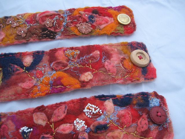 Wet felted embroidered cuffs.