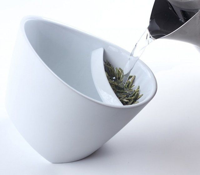 Tipping Teacup -   The teacup has an unusual angled bottom that allows it to rest in two different positions. On one side is a screened compartment in which you place your favorite loose tea leaves. Pour hot water through the screen and allow it to steep. Once it's done, simply tip the cup in the other direction, lifting the leaves up out of the water.  Made from SAN (thermo resistant food grade plastic) and features a glossy interior and matte exterior. Dishwasher safe, but not microwave…