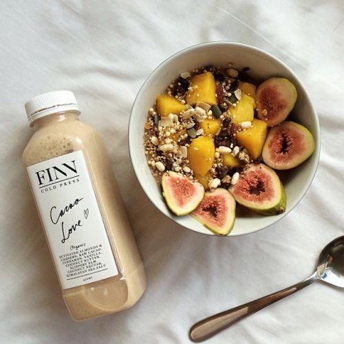 Cacao @organicburst maca oatmeal with mango, puffed quinoa/brown rice, pumpkin/sunflower/chia/sesame/pomegranate/amaranth seeds, goji berries and figs + @finncoldpress organic nut milk. Happy Sunday!