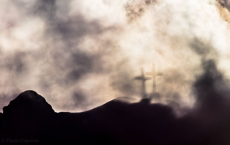 Shadow of a dream - Photo with the Gloria phenomenon (Brocken's spectre) caught from behind. Photo taken from the small town of Busteni, towards the Heroes Cross (elev. 2291m), located in the Bucegi Massif, Romania.