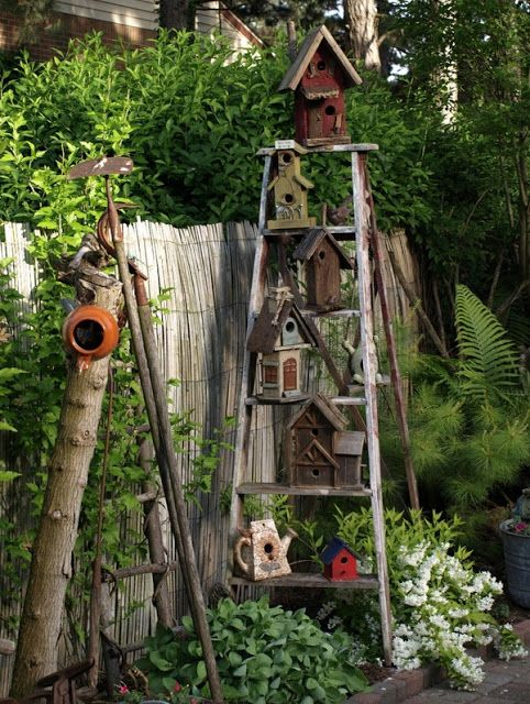 Love this ladder with a bunch of bird feeders on it! Old Ladders Repurposed As Home Decor