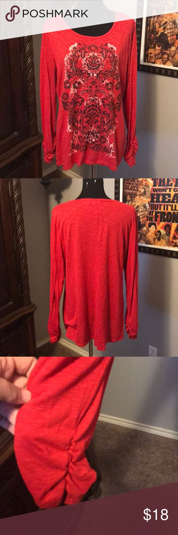 Red top Red long sleeve top with design and silver/black embellishments.  Drawn sleeves at the wrist.  Like new condition. Size is 18/20W Cato Tops Tees - Long Sleeve