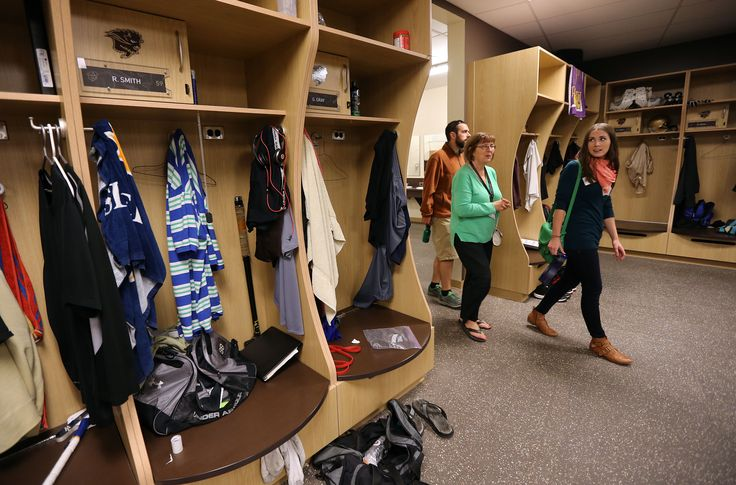 Visitors check out the Bison Football dressing room at the University of Manitoba Kinesiology-Recreation, Bison Sports and Rec Services open-house event at Investors Group Field at the U of M on Sept. 26, 2013. Photo by Jason Halstead