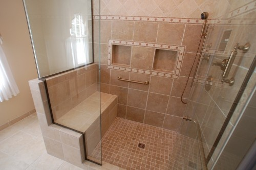 Shower with bench and places for shampoo. I would have the hand held shower with its' own valve by the bench.