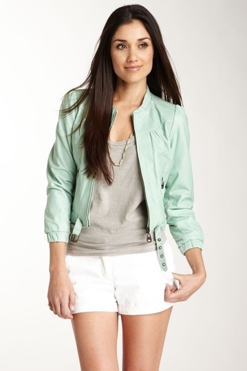 mint green leather jacket and white shorts