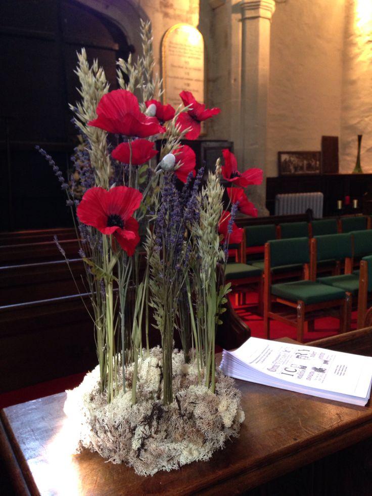 World War II Commemoration Service church flower arrangement. Dried flower oasis, silk poppies, reindeer moss, Lavender and wheat.