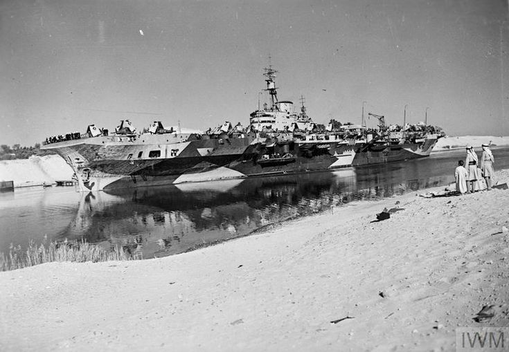 HMS Indefatigable, passes the Suez Canal, 1 December 1944. (IWM: A 26922)