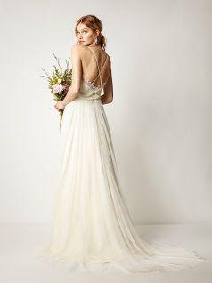 Zart, zarter, wie ein Hauch ist dieses wunderschöne Brautkleid im Bohemien-Chic.