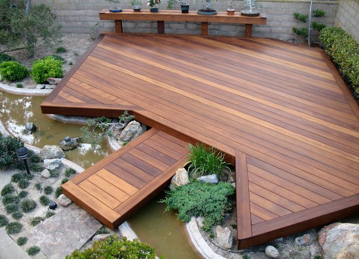 A floating deck over a stream makes a boring backyard beautiful