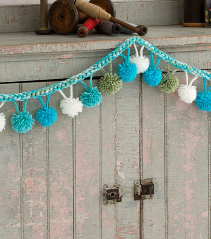 DIY Pom Pom Garland | Learn how to make your own pom-pom garland with yarn from @joannstores | Yarn Garland
