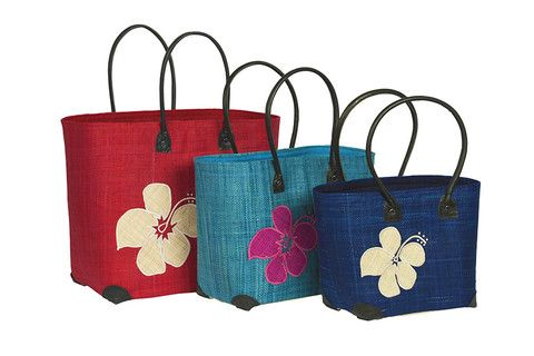 Hula Hula! Fun, summer festival and holiday all wrapped into one. The Hula Flower basket available in black, red, aqua and dark blue www.ravinala.co.uk #leather #raffia #drawstring #beachbag #strawbag #tote #basket