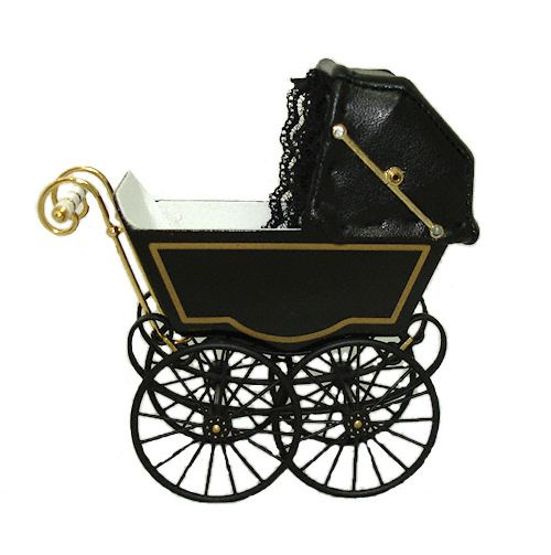 There's something creepy about this empty Victorian baby carriage by Heidi Ott (from Mainly Minis).