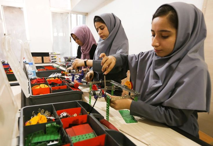 Members of a female Afghan robotics team, which was denied entry to the US for a competition, work on their robots in Herat province, Afghanistan, on July 4.