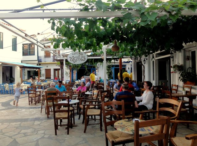 A little square with cafe terraces in Kokkari, Samos Island