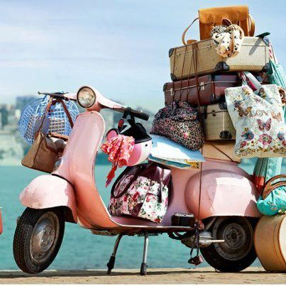 Pink Vespa ... girl's gotta have her stuff. Who can travel light? I can't.