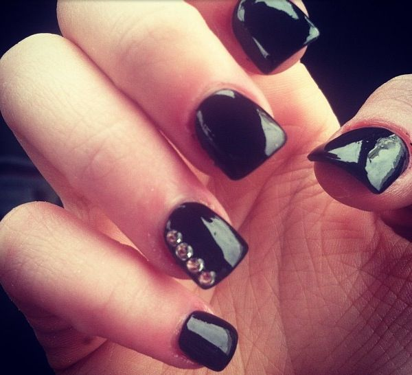Black nails with rhinestones.... I just got these and they're so cute