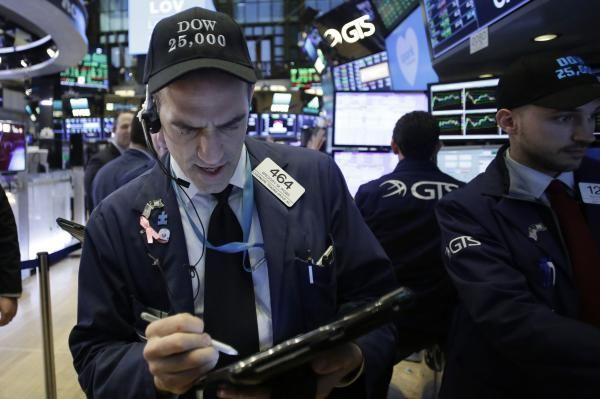 The Dow Jones industrial Average closed at more than 25,000 for the first time Thursday.
