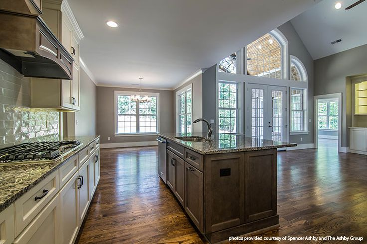 This incredibly open floor plan features a kitchen island overlooking every living space! The McKibbon home design 1119. #WeDesignDreams
