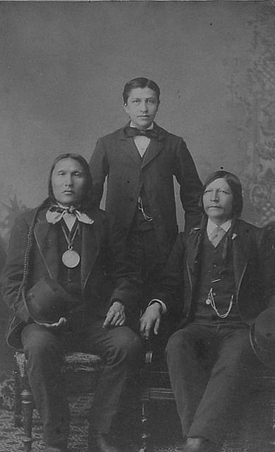 Photo of: Chief George Sanding Bear, his son, Luther (Plenty Kill) Standing Bear and Red Fish. All were Oglala Lakota Sioux. Luther became a author, educator, philosopher and actor. He did much for his tribe in promoting their holistic ways and respect of nature. Black Elk, Gertrude Bonnin, and Charles Eastman were all friends. Henry was Luther's brother and Pretty Face, was his mother. Ota Kte, 1868-1939 ca Carlisle Indian School by DickinsonLibrary, via Flickr
