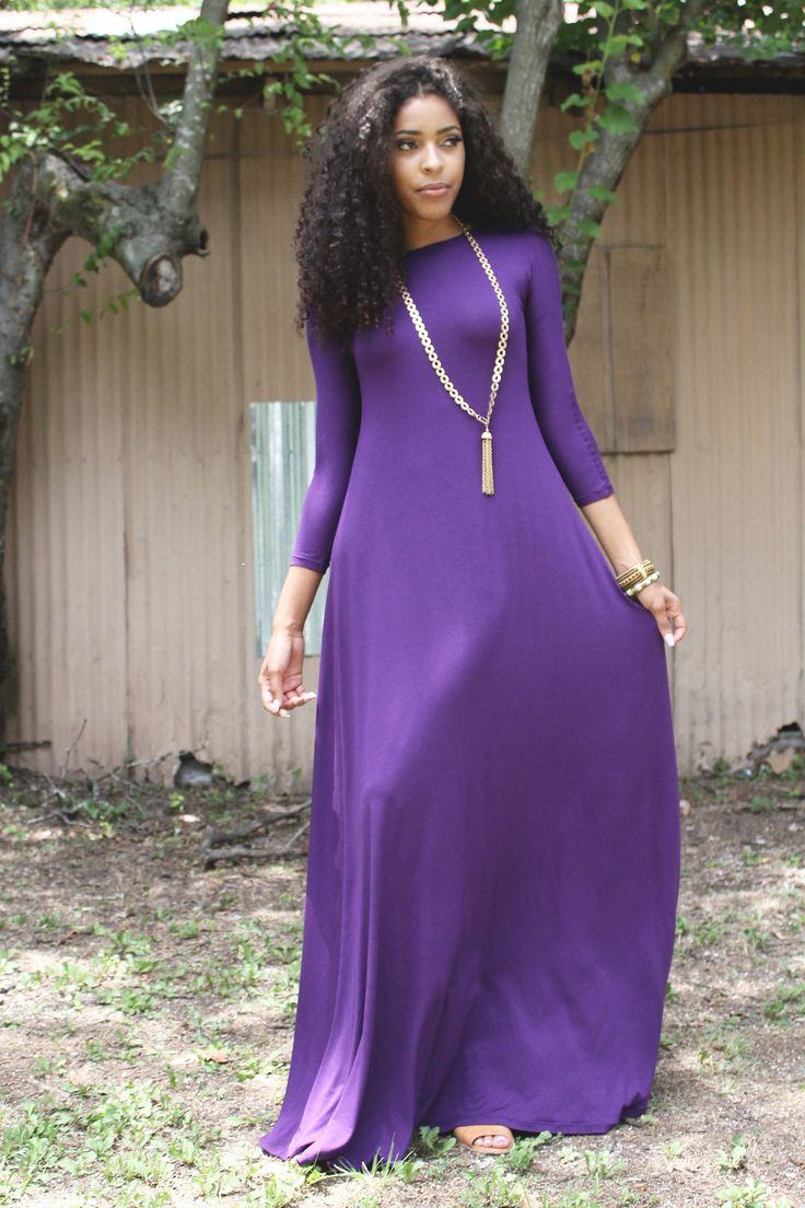"Norah Purple Maxi Dress-  Comfort meets elegant simplicity with the  purple 3/4 sleeve Norah Maxi Dress. This fresh and modest look gives a sensual dimension to the body, enhancing every angle and flowing freely on the body. This relaxed fit dress is made in a flowing cotton jersey knit.  Length  Petite:  53"" /  134.62 cm Standard:  58"" / 147.32 cm   Tall:  63"" / 160.02 cm"