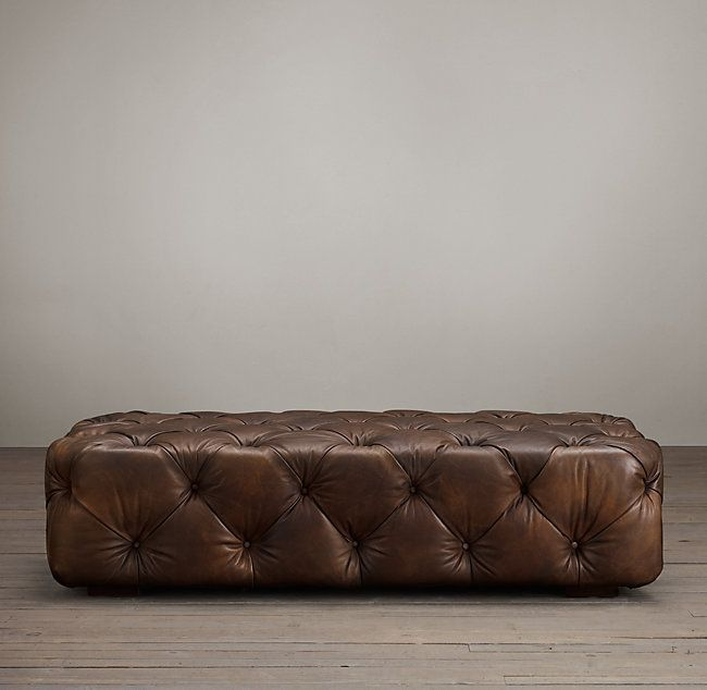RH's Soho Tufted Leather Ottoman:Grandly proportioned, with a low seat, plush padding and allover button tufting, our Soho Ottoman is comfort writ large. Its lavish styling recalls the classic Chesterfield – plush seating for London's turn-of-the-century gentlemen's clubs – but a rakishly low profile imbue it with contemporary, of-the-moment style.