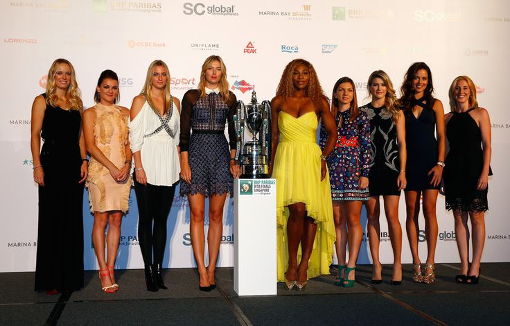 Maria Sharapova Photos: BNP Paribas WTA Finals: Previews. Players, Caroline Wozniacki of Denmark, Agnieszka Radwanska of Poland, Petra Kvitova of Czech Republic, Serena Williams of USA, Maria Sharapova of Russia, Ana Ivanovic of Serbia, Eugenie Bouchard of Canada and Simona Halep of Romania pose for a photo after the draw during previews for the WTA Finals at the Marina Bay Shopping Centre on October 18, 2014 in Singapore.