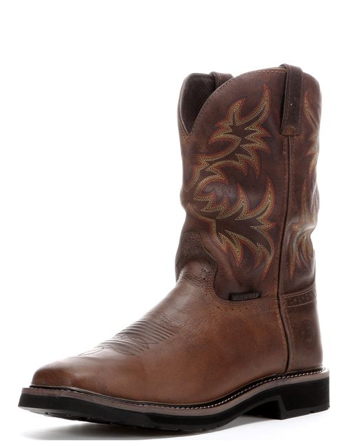 """Work hard, rest easy in the Justin Rugged Tan Cowhide 11"""" Waterproof Stampede Square Toe Boot. Justin work boots have been known for their durability, style, and comfort since day one, and it's easy to see why.The J-Flex Flexible Comfort System® offers broken-in comfort right out of the box. This system features cushioned, leather-covered insoles and triple-density insole boards for generating energy return and reducing fatigue from working on your feet all day. The outsole is ..."""