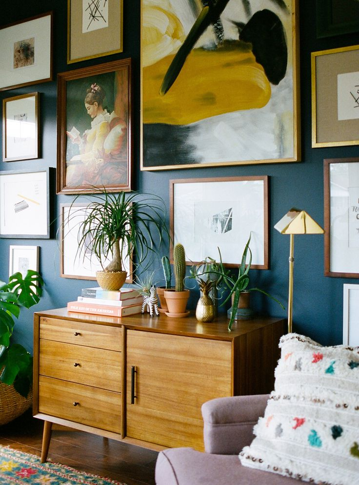 Salon wall, deep teal colour with golden accents