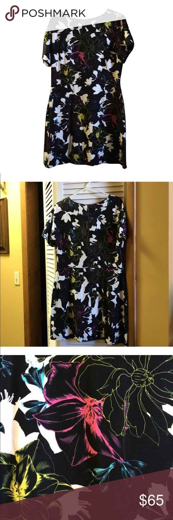 French Connection Short Sleeve Dress Cute dress with pockets and a colorful floral pattern. Great condition. Some wrinkles from storage, but nothing that can't be remedied easily. French Connection Dresses Mini