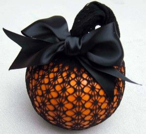 Old pair of fish nets. Push pumpkin through and tie knot at top, topping it off with pretty ribbon