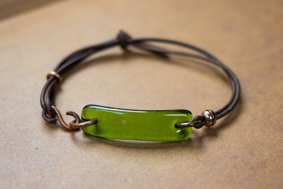 NEW DESIGN. Adjustable leather bracelet and recycled Wine Bottle Glass adorned in hand oxidized real copper. Its completely adjustable AND has a clasp. Adjust it once for the perfect fit and then use the sweet handmade clasp for easy on and off. My recycled glass jewelry is artisan quality to be enjoyed for years to come. The reclaimed glass is hand cut, shaped, polished and then kiln fired for superior strength and shine. Makes a great eco-friendly gift for him and for her.  Glass: Wine…