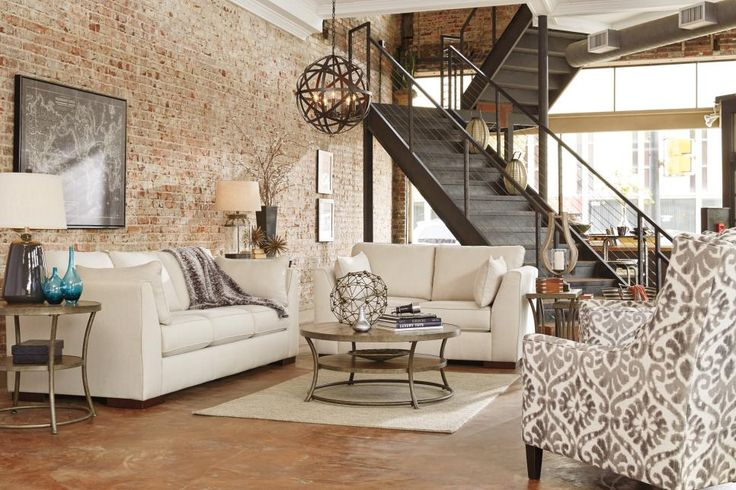 Industrial-chic elements speak for themselves thanks to our nice and neutral Pierin seating. Plush cushions provide a comfy respite from this room's metal staircase and rough brick walls.