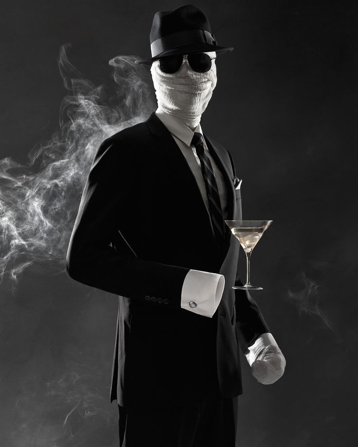 Is he perhaps the victim of an experiment gone awry? All we know is this once-dapper gent has nearly faded away. Now he lurks under the cover of a gauze mask and dark glasses. Even his drink of choice -- a crystal-clear Gibson -- is invisible; its unraveling pickled-onion garnish resembles the bandages that shield his secret from the world.