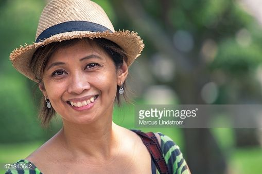 Stock Photo : Portrait of a happy woman outdoors in the park