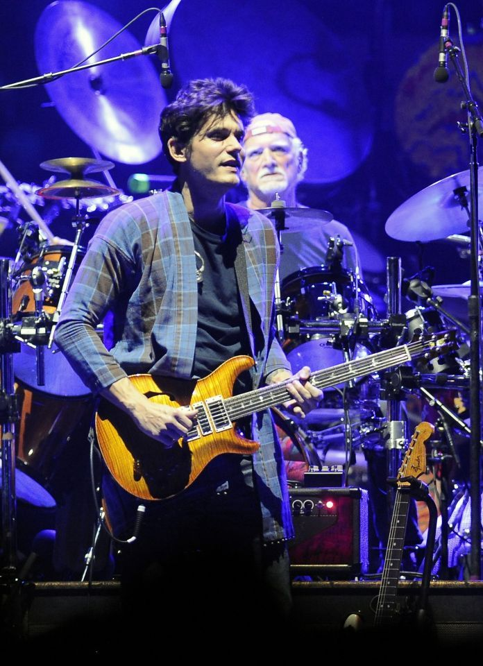 John Mayer ,left, plays with Grateful Dead members Mickey Hart, Bill Kreutzmann, Bob Weir, and musicians Oteil Burbridge, and Jeff Chimenti to form the band Dead & Company during a show at Times Union Center in Albany, N.Y.,Thursday, Sept. 29, 2015. The band performs this Sunday and Monday at Bill Graham Civic Auditorium in San Francisco.