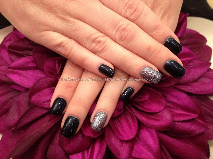 Acrylic nails with midnight satin and glitter gel on ring finger