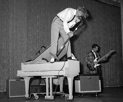 "Jerry Lee Lewis - 'The Killer. The bad boy. He put everything he had into his performances. He became known nationwide in 1957 with ""Whole Lotta Shakin' Goin' On"" then had successive hits with ""Great Balls of Fire"" and ""Breathless."" ' S)"