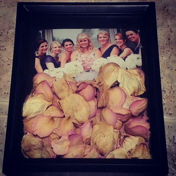 Preserved bridal bouquet petals in a shadow box for my wedding photo gallery wall. Keep the beauty of the bouquet on display to enjoy it every day!